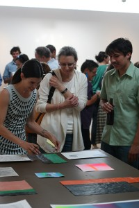 Viewers purchasing some of the work on display. Image courtesy Allyson Feeney