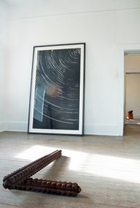 Foreground: xast iron sculpture. Background: a related wood print made using the iron sculptures. Image courtesy Exhibitions 2D