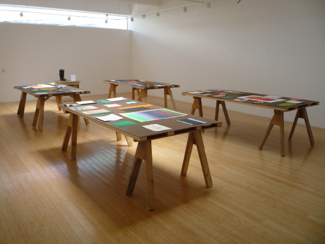 Tables lined with works filled the Marfa Book Co. gallery. A small table in the back was dedicated to the volunteer fire department. Image courtesy Nick Terry.