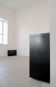 Installation view of Susan York's solid graphite works. Image courtesy Exhibitions 2D