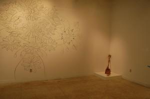 Wall mural and shovel by Margarita Cabrera