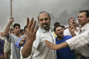 Kael Alford,  Zafrania, April 26, 2003. Angry residents of Zafrania confront U.S. soldiers guarding an ammunition stocklpile after an accident launched a missile that killed people in nearby houses. Courtesy Kael Alford/Panos
