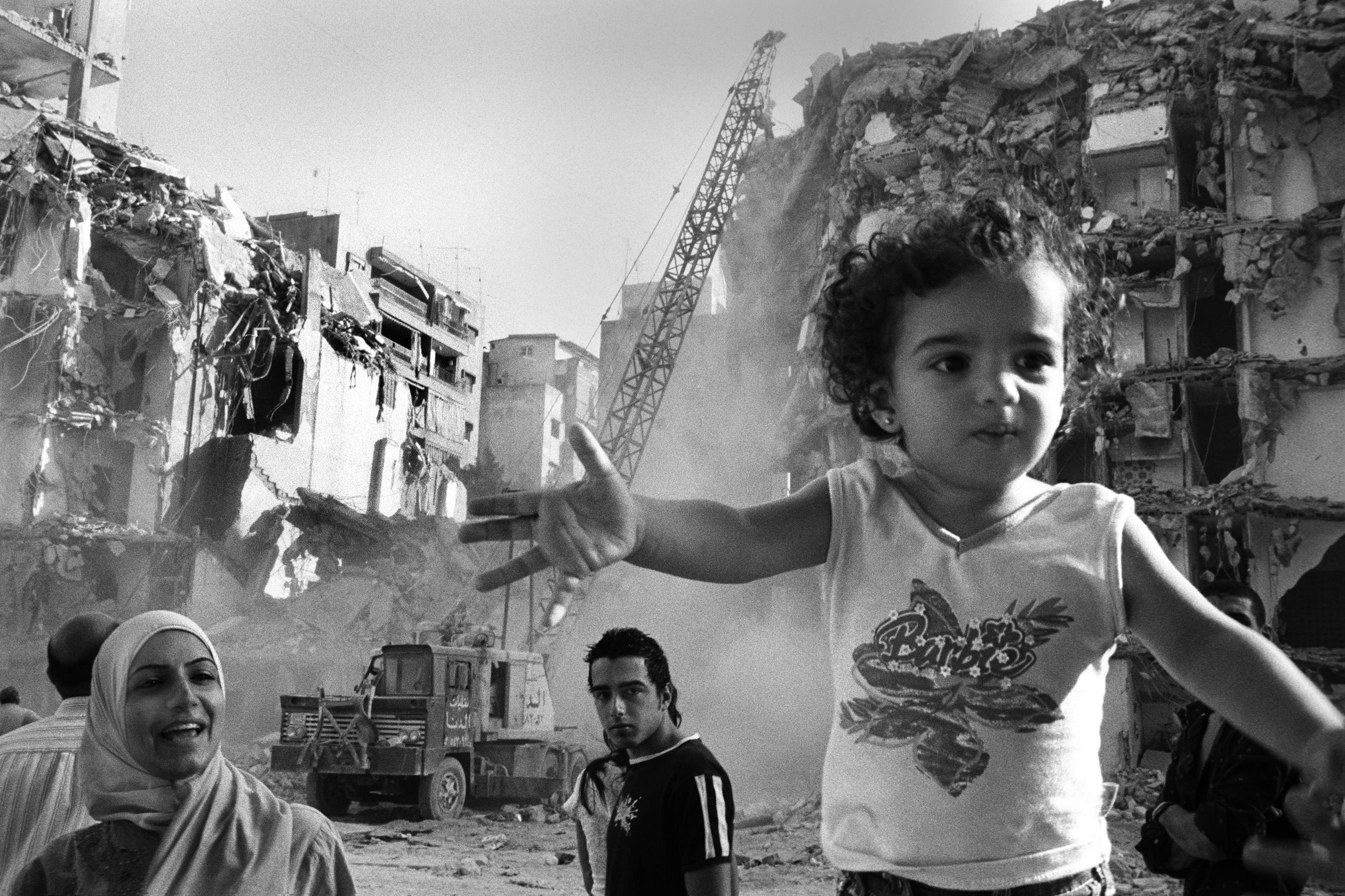 Rania Matar  Barbie Girl, Beirut 2006. Haret Hreik Beirut. The photographer arrived in Beirut to visit family days before the bombing of Lebanon by Israel started in 2006. Courtesy Rania Matar