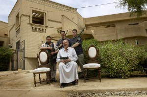 A man with his sons in the wealthy neighborhood of Qasadiya guard their street from looters. The neighborhood has about 20 armed men who patrol 24 hours a day to keep theives at bay who have ransancked the homes of government employees and Hussein family palaces in the area.