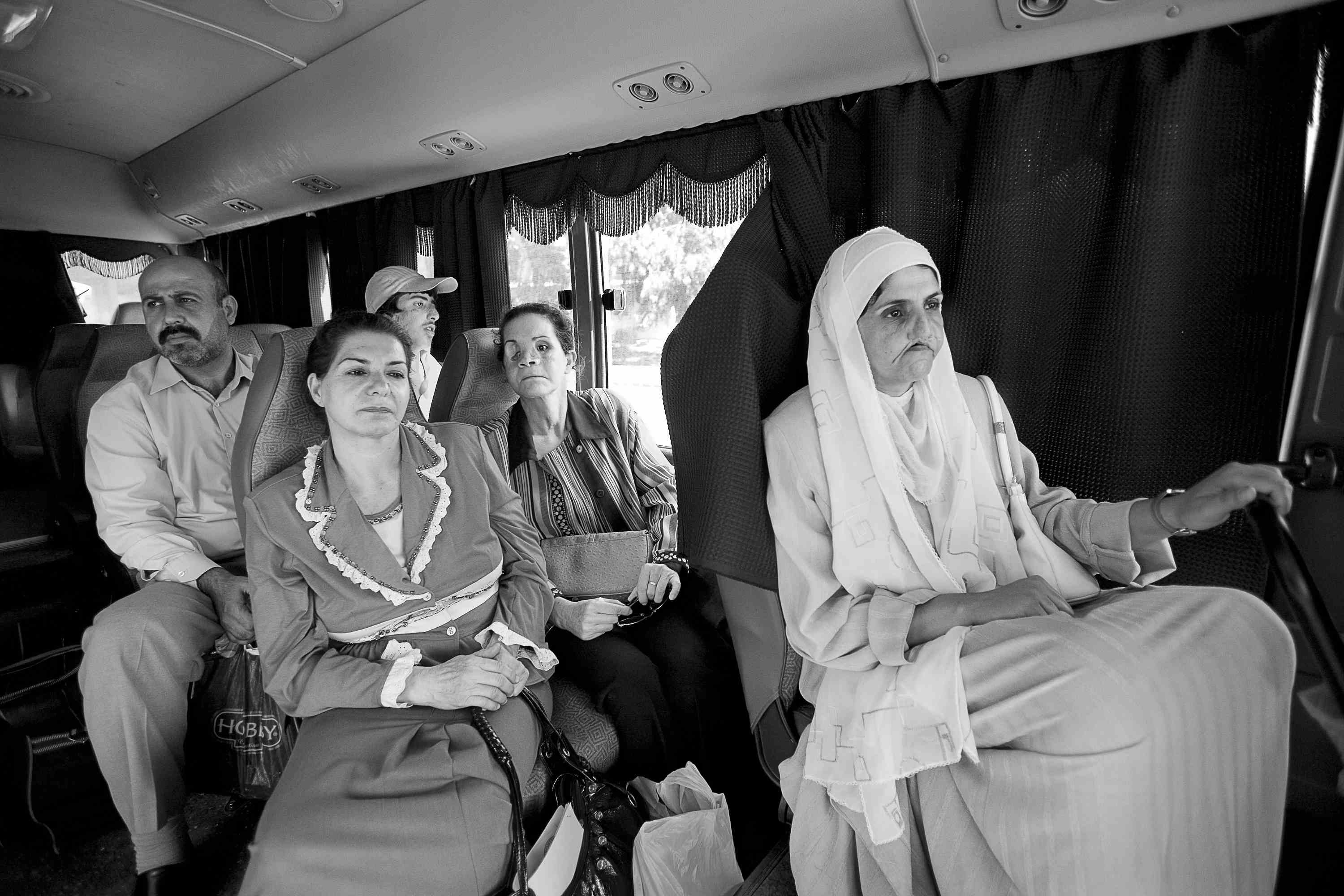 Lori Grinker,  Untitled: Bus ride from airport. Wounded Iraqis on their way to Jordan for treatment by Doctors Without Borders at the Red Crescent Hospital in Amman, Jordan, September 2007.