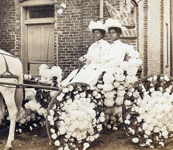 Martha Yates Jones & Pinkie Yates at Antioch Baptist Church in a buggy decorated for the annual Juneteenth celebration (c. 1905). Courtesy of Houston Metropolitan Research Center, Houston Public Library.