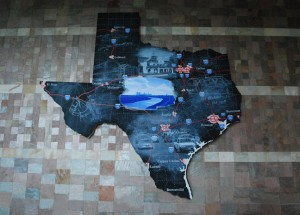 """Modern Texas"", 2005, Vernon Fisher, Fort Worth Convention Center, 1111 Houston St., 2nd floor by the Ballroom on southside of building, Downtown. One of two super-sized blackboard maps of Texas by nationally-recognized Fort Worth artist Vernon Fisher. This map charts the state's major cities, highways and prominent Fort Worth landmarks, such as the Fort Worth Live Stock Exchange Building."