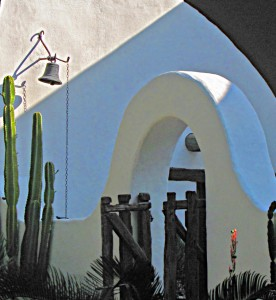 Garden Arch and bell, View of the courtyard of the Spanish Governor's Mansion (actually used as the predidio HQ), pre-USA SA. There's a Hapsburg crest at the front of the building, built in around 1720.