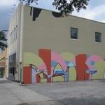 Daniel Anguilu paints Famous Monsters on Lawndale's big big wall