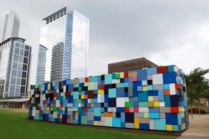 """Synchronicity of Color - Blue (2008)"", Margo Sawyer, Discovery Green, 1500 McKinney, Downtown. Downtown Houston is in the middle of an urban renaissance, thanks to Discovery Green, a 12-acre public/private urban redevelopment project next to the George Brown Convention Center and Minute Maid Park. Parks, gardens and public art have helped to make it an attractive place to live and visit. Artist Margo Sawyer's colorful stacks of metal boxes were commissioned for the site and help to obscure underground garage stairways. Nearby is a 30-foot tall Jean Dubuffet outdoor sculpture and San Francisco artist Doug Hollis's ""Mist Tree"" and ""Listening Vessels""."