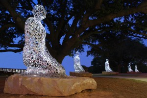 """""""Tolerance"""" (2011) Jaume Plensa, Buffalo Bayou, Allen Parkway @ Montrose Blvd., Montrose This civic art installation was commissioned and funded by Houston philanthropist Mica Mosbacher and a group of private donors to depict """"tolerance, harmony and diversity"""" in Houston.  Spanish artist Jaume Plensa, whose outdoor sculptures have been installed all over the world, designed a series of seven kneeling figures and placed them under the majestic oak trees along the Buffalo Bayou jogging path. According to the artist, the ten-foot tall figures represent the seven continents of the world. The figures are fabricated out of jumbled stainless steel lettering derived from alphabets across the globe."""