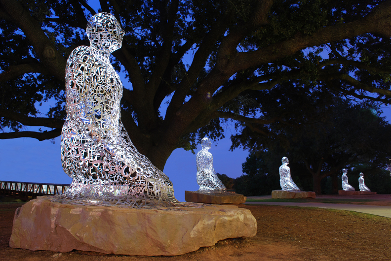 """Tolerance"" (2011) Jaume Plensa, Buffalo Bayou, Allen Parkway @ Montrose Blvd., Montrose This civic art installation was commissioned and funded by Houston philanthropist Mica Mosbacher and a group of private donors to depict ""tolerance, harmony and diversity"" in Houston.  Spanish artist Jaume Plensa, whose outdoor sculptures have been installed all over the world, designed a series of seven kneeling figures and placed them under the majestic oak trees along the Buffalo Bayou jogging path. According to the artist, the ten-foot tall figures represent the seven continents of the world. The figures are fabricated out of jumbled stainless steel lettering derived from alphabets across the globe."