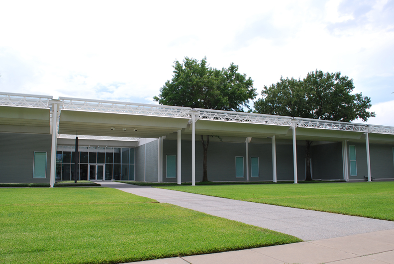 "The Menil Collection, 1987, architect Renzo Piano Building Workshop, 1515 Sul Ross St. The legendary collection of John and Dominque de Menil was almost fifty years in the making before it ended up in this museum specifically designed for it. It was the first U.S. commission for Italian architect Renzo Piano and his Building Workshop and is known for its inventive manipulation of natural light. Like the de Menils, the museum is quietly elegant and simple in design. One of the mandates to Piano was to design a building that seemed ""large on the inside, but small on the outside"", since it is sited in the middle of a neighborhood of bungalow homes."