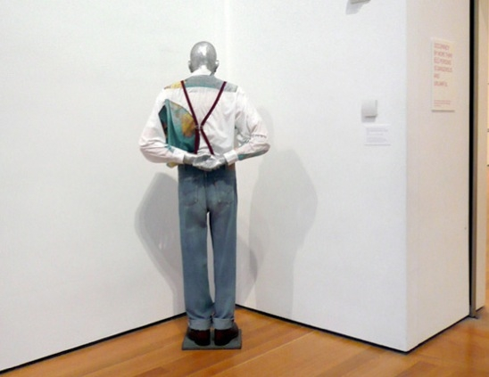 Martin, into the Corner, You Should Be Ashamed of Yourself Martin, ab in die Ecke und schäm dich 1992 Cast aluminum, clothing, and iron plate, 68 7/8 x 31 1/2 x 15 3/4 in. The Museum of Modern Art, New York, Blanchette Hooker Rockefeller Fund Bequest, Anna Marie and Robert F. Shapiro, Jerry I. Speyer, and Michael and Judy Ovitz Funds © Estate Martin Kippenberger, Galerie Gisela Capitain, Cologne