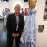 Duane Reed and a sculpture by Michael Lucero.  By the way Mr. Reed, I love the whole Leaning Tower of Pisa look you got going on there.