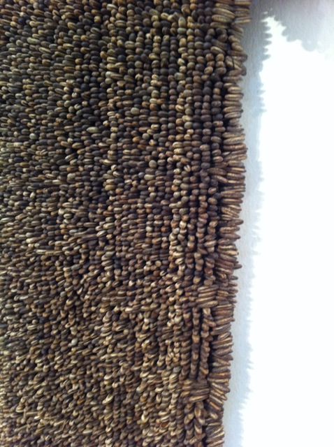 Detail of an amazing seed dress/cassock by Xawery Wolski at Diana Lowenstein Fine Art.