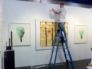 The late great Chuck Ramirez's work being hung at Ruiz-Healy Art.