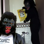 "Guerrilla Girls, Photograph of Guerrilla Girls in bathroom with sign, ""The Birth of Feminism"". Courtesy of the Guerrilla Girls"