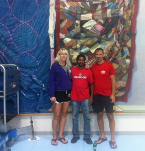 As was the case with many ArtPrize artists, Sedrick Huckaby had a chance to become friends with his venue hosts. Here, prior to de-installing his painting, Huckaby stands with Michelle and David VanderMeer, owners of Carpe Diem Volleyball.
