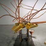 The kinetic sculpture's bronze tentacles pinched and grasped