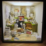A display of objects recreated from a photograph of a Fluxus store