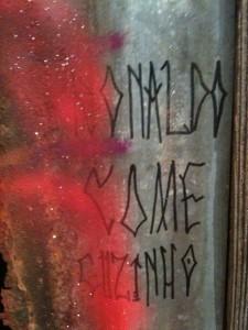 "Hut entrance graffiti detail, ""Ronaldo come cuzinho,"" translates from Portuguese as ""Ronaldo eats ass."""