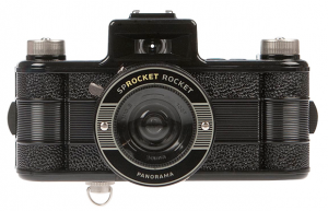 Sprocket Rocket Lomography Film Camera. A new Lomographic experience: the Sprocket Rocket boasts a super-wide angle lens for panoramas, dual winding knobs for easy multiple exposures and of course, sprockets! Uses 35mm film. $90 @ the Dallas Museum of Art.