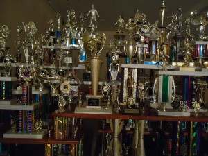 Ry Rocklen, Second to None, 2011, trophies, trophy parts, wood, 94.5 x 146 x 39 in. (240 x 370.8 x 99.1 cm.).