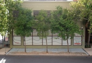 """Front view of Artpace, showing Boyd's painted/chalked waves. the visual component of """"Natural Black."""""""