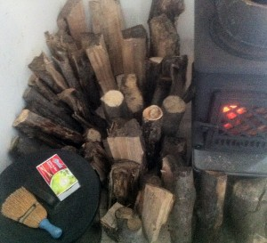 Using the stove to dry out wood to put in the stove.
