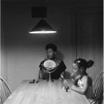 "Carrie Mae Weems, ""Untitled (Woman and daughter with makeup)"" from ""Untitled (Kitchen Table Series),"" 1990. Silver print, 27 1/4 x 27 1/4 inches. Courtesy the artist and Jack Shainman Gallery, New York."