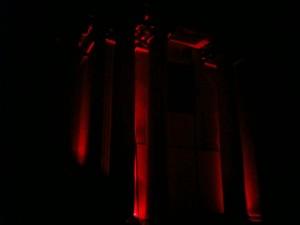 We were all ushered into a dark room.  The only lights were red ones illuminating the massive columns in the space