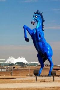 """""""Mustang,"""" a 32-foot tall, 9000 lb. cast fiberglass sculpture at Denver International Airport."""