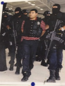 A photograph tacked to the studio wall of Rigoberto Gonzalez