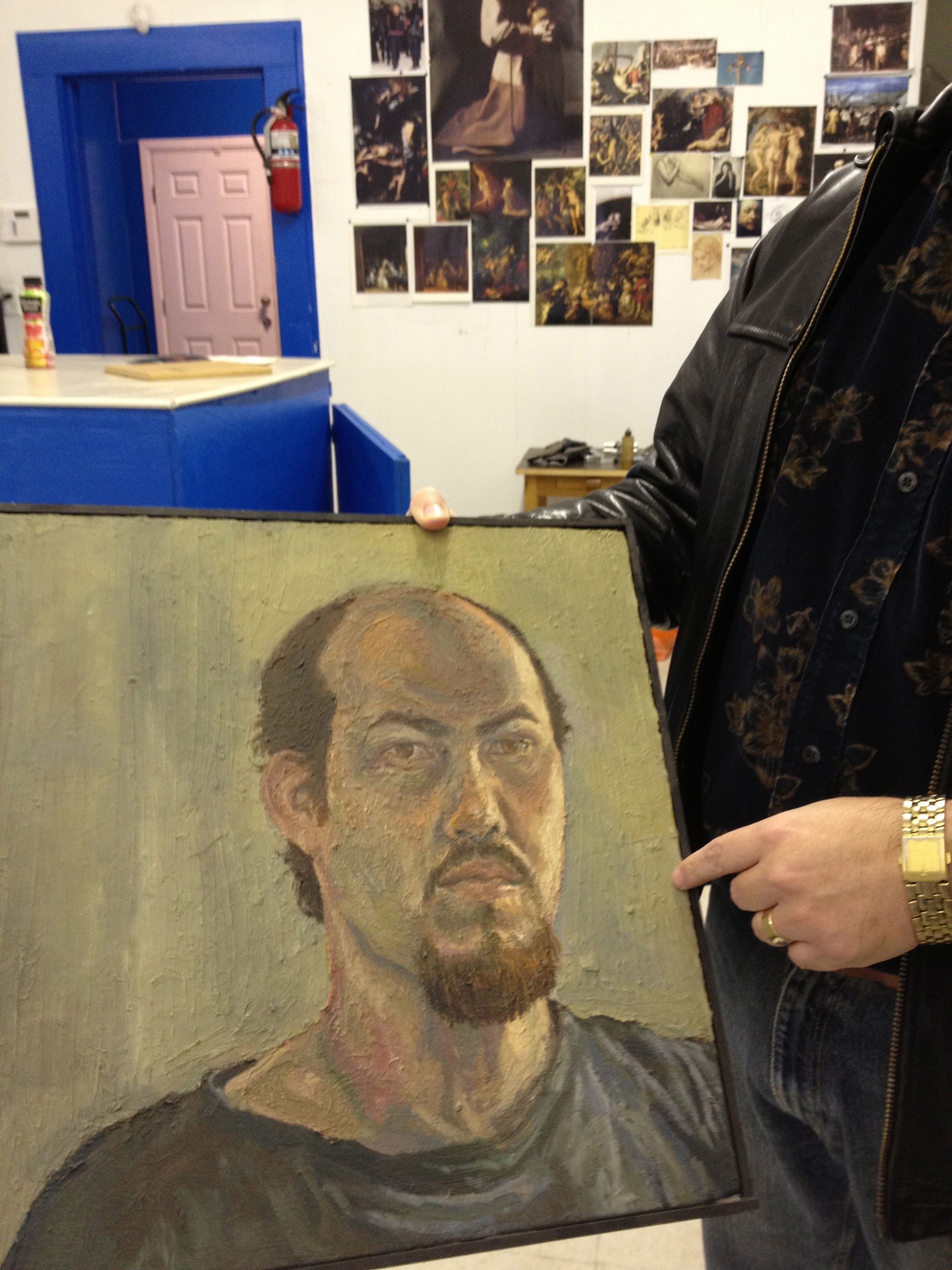 "Rigoberto Gonzalez in the studio with a self-portrait ""from a long time ago"""