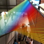 Gabriel Dawe, Plexus C3, Gutterman thread, wood, hooks, 20'x4'x12', 2012. Installed in the fair's stairwell.