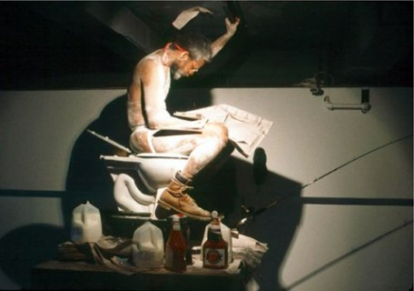 "William Pope.L, ""Eating the Wall Street Journal,"" 2000. Performance, newspaper, toilet, milk, ketchup."