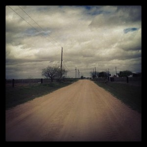 A dirt road near San Benito, Freddy Fender's hometown. There's a water tower there with a portrait of him.  Hidalgo County.