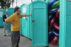 Untitled, 2006 Materials : Rented Port-o-potty, 28 inflated vinyl donut/rings, Ben Judson