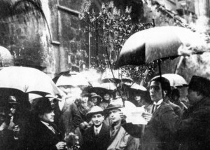 "Tristan Tzara reads to the crowd at a ""Dada excursion"" at St. Julien le Pauvre church, 1921, Paris"