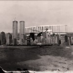 NYC attacked by giant biplane, and who&#039;s the figure peeking out over the building at right? And what kind of terrain is that/ is it water?