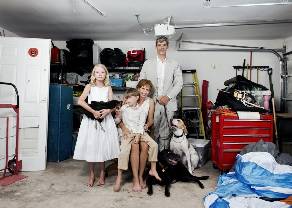 "This is a complete traditional family portrait that includes our children, dogs (Onyx and Penny) and chicken (Chocolate) in the not-so-traditional setting of our garage.  The garage was the setting of ""Accumulation"" and we also use it for developing new projects and of course, storing the lawn mower."