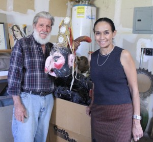 Mexic-Arte Founder Sylvia Orozco receives Mask Collection from Mr. Carmine De Vivi during a recent visit to New Mexico.