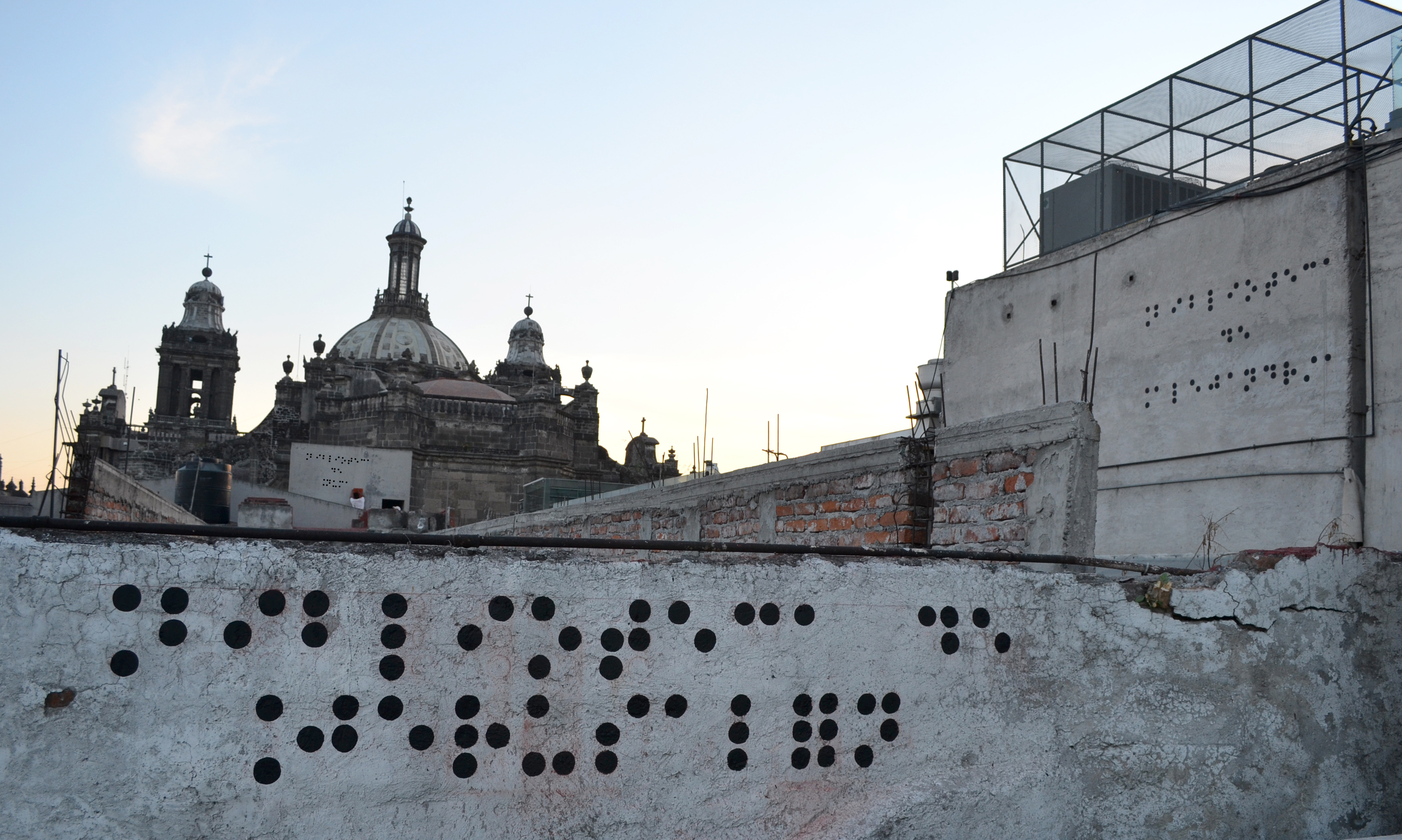 Biblioteca Ciega (Bilioteca de Jerusalén, Numa Alejandria), Vinyl on the surrounding buildings of the Historic Center of Mexico City, 2012