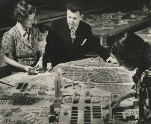 Norman Bel Geddes with Futurama Diorama, Photograph by Richard Garrison, ca. 1939.  Image courtesy of the Edith Lutyens and Norman Bel Geddes Foundation / Harry Ransom Center.