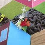 Variable Landscape, detail, plywood, paint, foam, stain, plastic plants, mounted giclee prints, 110 x 192, 2013