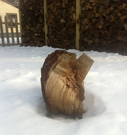 Outdoor sculpture and picture-perfect rack of firewood.
