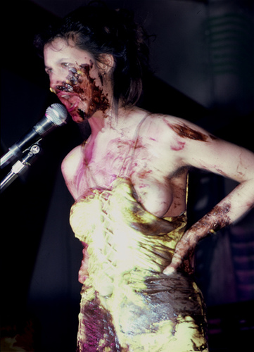 Performance artist Karen Finley. Performance smearing herself with chocolate. New York, 1982.