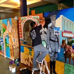 """Jesus """"Cimi"""" Alvarado working on his murals."""