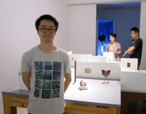 Artist with his piece in the Central Academy of Fine Arts student sculpture exhibition